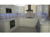 Ex Display Gloss Handleless Kitchen for Sale with Mistral Worktops & AEG Appliances