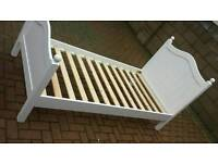 White painted single bed with mattress