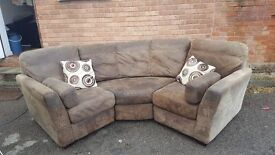 Nice curved corner sofa. used,could do with little clean.can deliver