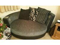 SCS grey /black cuddle sofa can deliver