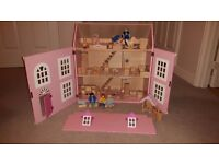 Wooden dolls house with approx 60 accessories