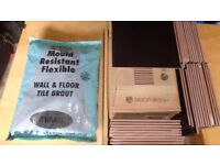 2.25 Sq yards of Black Tiles with a bag of Grout