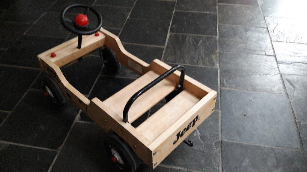 Child's wooden ride on' jeep' car