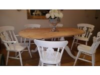 Shabbychic country pine dining table and 6 fiddleback dining chairs.