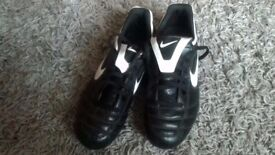 2 pairs of kids football boots