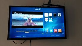 Smart tv freeview bush with box and remote good condition