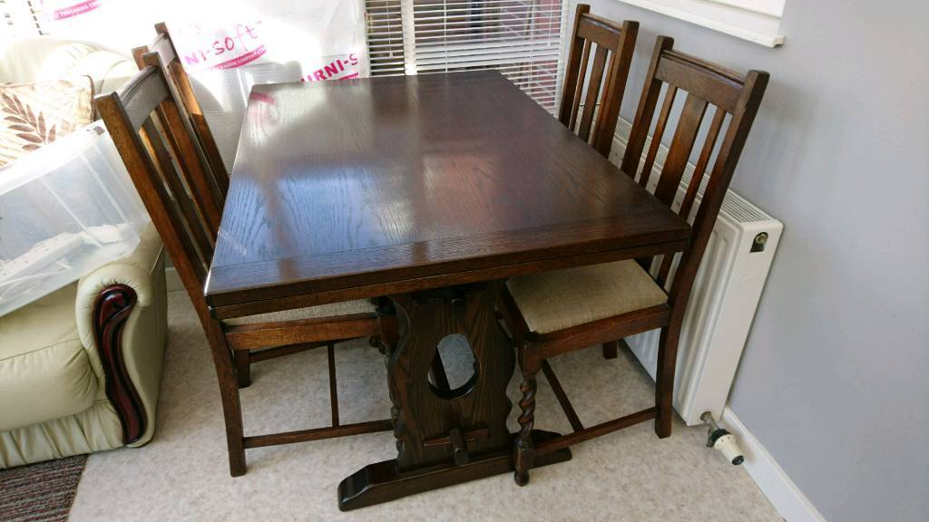 reduced ercol dark oak dining table and four antique barley twist chairs - Dark Oak Dining Table