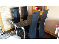 Extending dinning table and 4 chairs( £120 ONO)