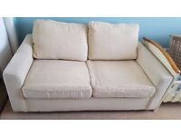 Beige two seater, double sofa bed.