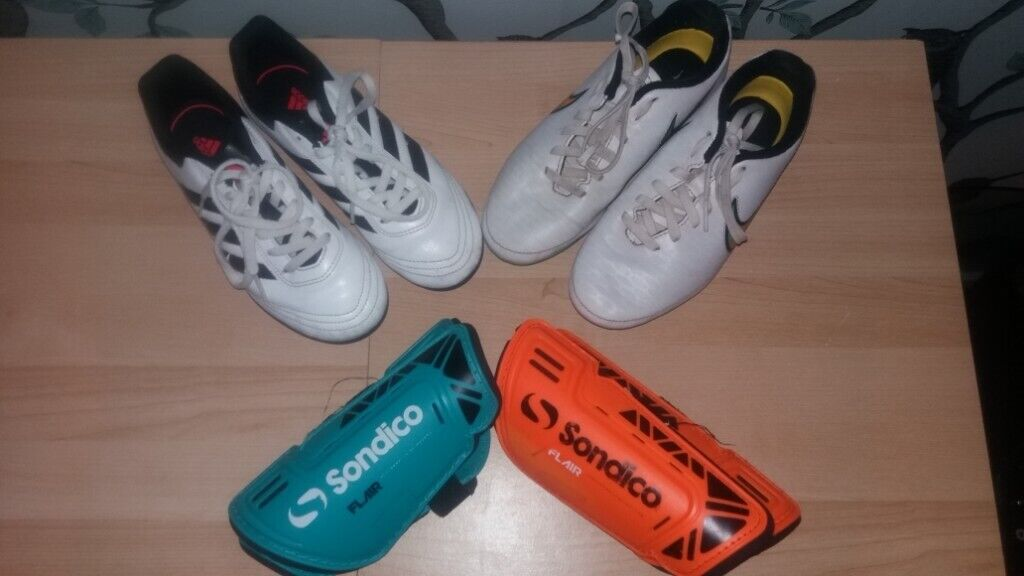 0c4d7e78b20 Kids football boots and pads