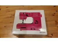 John Lewis Mini Sewing Machine, pink, unwanted gift, excellent condition.