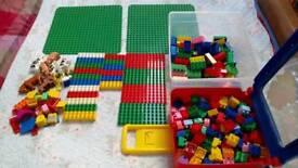 Two boxes of Lego Duplo and Mega Blocks.