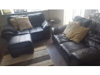Two black leather sofas plus storage footstool