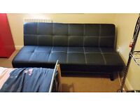 Black faux leather clip down sofa bed. Extremely good condition. Collection only. £80 ono