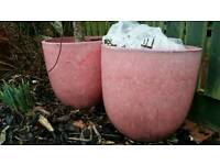 Pair of large pink ceramic plant pots