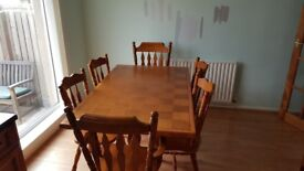Solid wood table and 2 carver chairs and 4 dining chairs