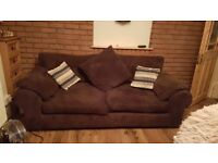 Two large brown sofas