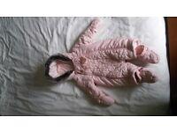 Babies pink snow suit.