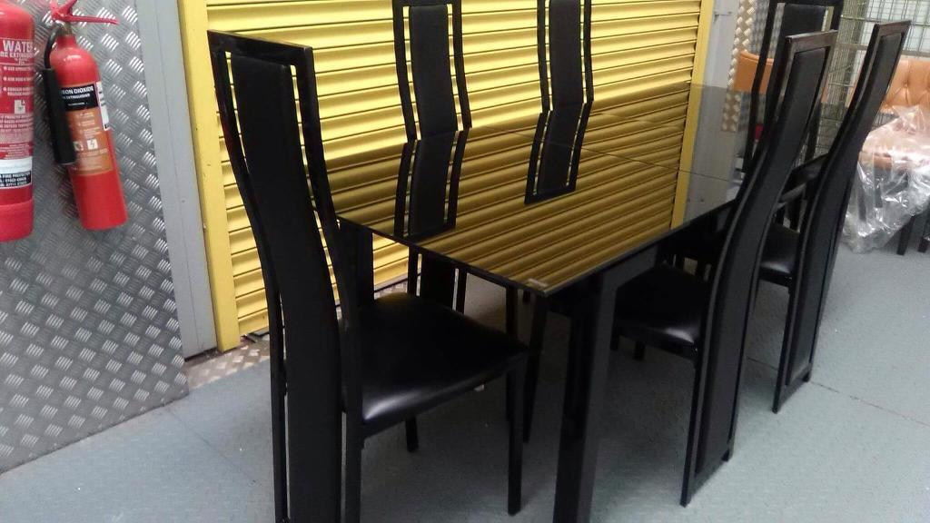 Glass extending dining table and chairs