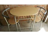 Table and two chairs £20