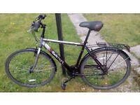 Apollo Belmont 21 inch men's hybrid bike good condition 18 speed mudguards pannier rack and lights
