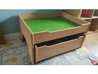 Kids play table with rolling drawers