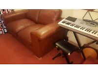 DFS Tan Leather Sofa in very good condition. Only selling because of space needed over xmas