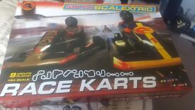 Brand new unopened scalextric race carts