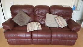 Dark red leather sofa. 3 seater