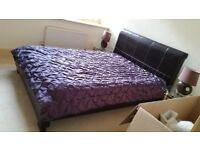 Brown leather queen sized sleigh bed frame and memory foam mattress