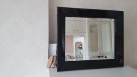 Mirror with black surround 64cm x 54cm.