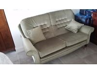 Two green sofas with matching cushions and footstools. REDUCED
