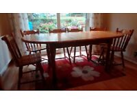6 seater oval pine extending dining table with six chairs
