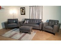 Rally grey leather buttoned back 3 seater sofa, snuggler chair, standard chair and footstool
