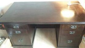 Lombok Directors Desk, Dark teak 6 drawers, in very good condition.