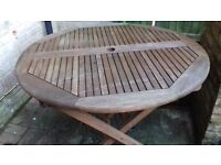 nice wood round table and 4 chairs