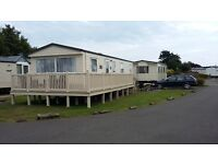 PRESTIGE RATED CARAVAN, WITH VERANDA, FOR HIRE AT COMBE HAVEN IN HASTINGS
