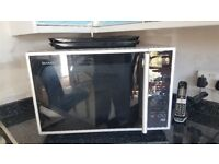 Sharp Combination Microwave oven for sale.