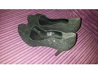 ladies size 6 heels black with sparkle silver.