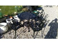 metal garden table and 4 chairs very nice