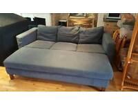 Dark blue 4 seater sofa with matching pouffe same length. £120 ono
