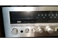 sansui amp with speakers and a dvd