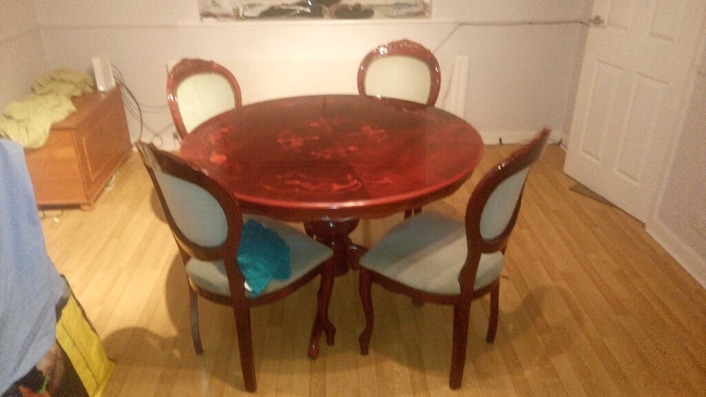 Lacquered round dining room table with 4 chairs