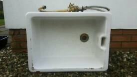 Belfast sink with brass tap