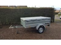New Car trailer Brenderup 1205s XL with flat cover.