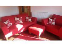 Red sofa suite.