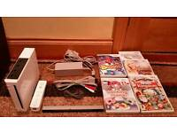 NINTENDO WII CONSOLE WHITE MODEL NO. RVL-001 COMPLETE WITH ALL LEADS, CONTROLLER, 4 GAMES & 1 MOVIE