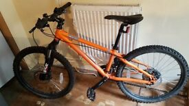 Boys 24 inch Genesis Core Mountain bike, Orange.