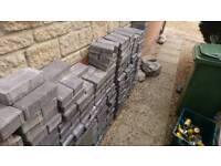 620 paving blocks. Just over 12 square metres.