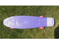 Genuine Penny Skateboard with Purple deck in very good condition